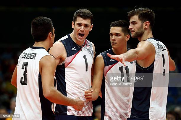 Matthew Anderson Micah Christenson Aaron Russell and Taylor Sander of United States react against France during a Men's Preliminary Pool B match on...