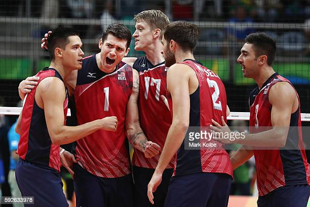 Matthew Anderson of United States celebrates with his team after a point during the Men's Bronze Medal Match between United States and Russia on Day...