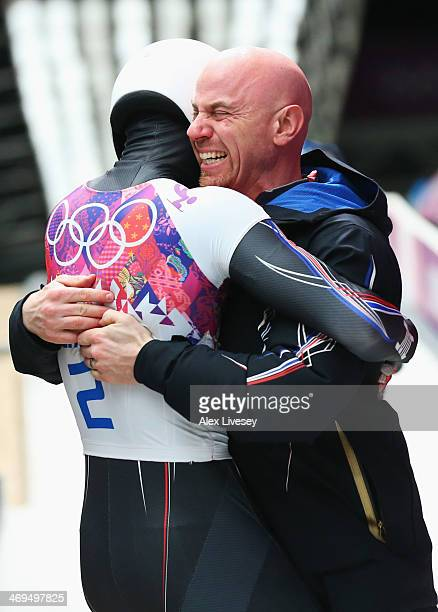 Matthew Antoine of the United States celebrates after his run during the Men's Skeleton on Day 8 of the Sochi 2014 Winter Olympics at Sliding Center...
