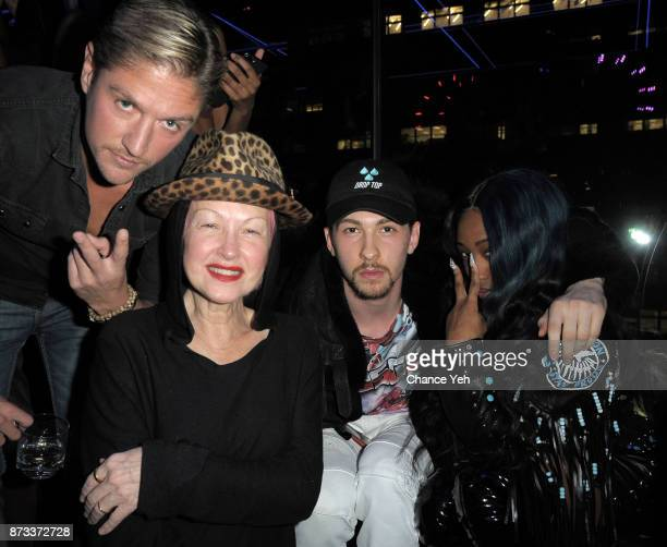 Matthew Assante Cyndi Lauper Dex Lauper and Brittney Taylor attend TPain's performance during Sunset Saturday at PhD Dream Downtown Hotel Rooftop on...