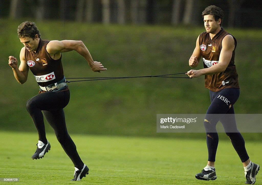 Matthew Ball of the Hawks drags Nathan Thompson during the Hawthorn Football Clubs training session at Ausdock Oval April 20, 2004 in Melbourne, Australia.