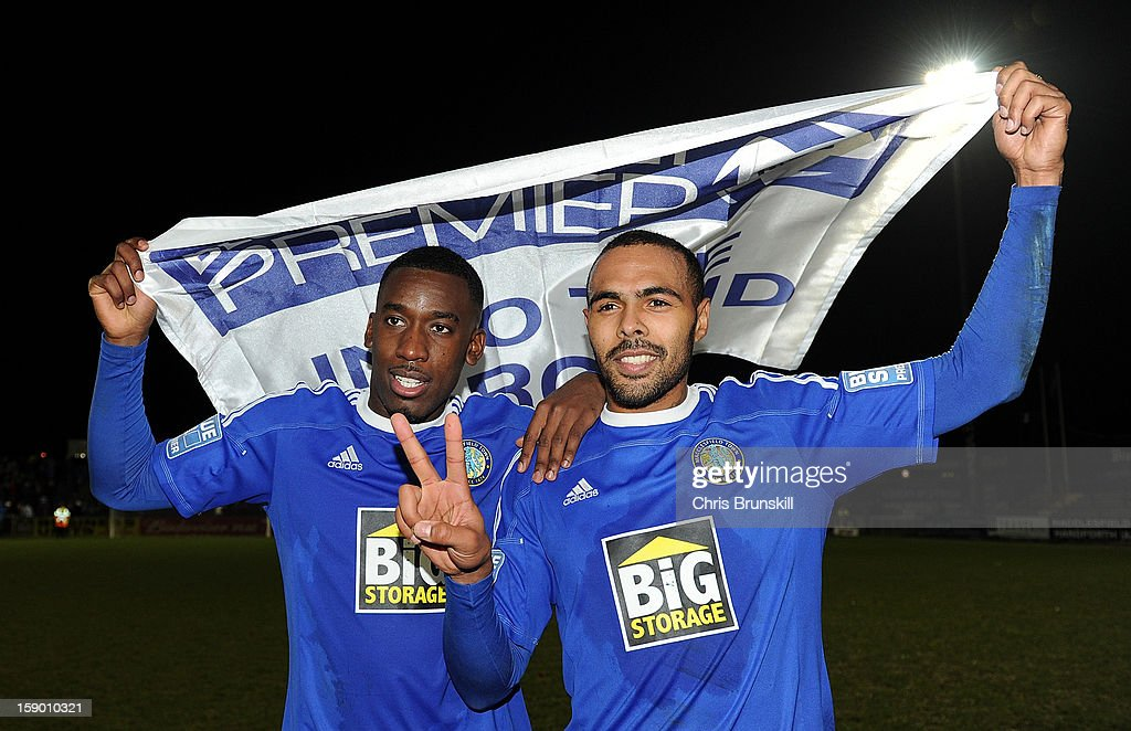 Matthew Barnes-Homer (R) of Macclesfield Town celebrates at full-time with team-mate Amari Morgan-Smith following the FA Cup with Budweiser Third Round match between Macclesfield Town and Cardiff City at Moss Rose Ground on January 5, 2013 in Macclesfield, England.