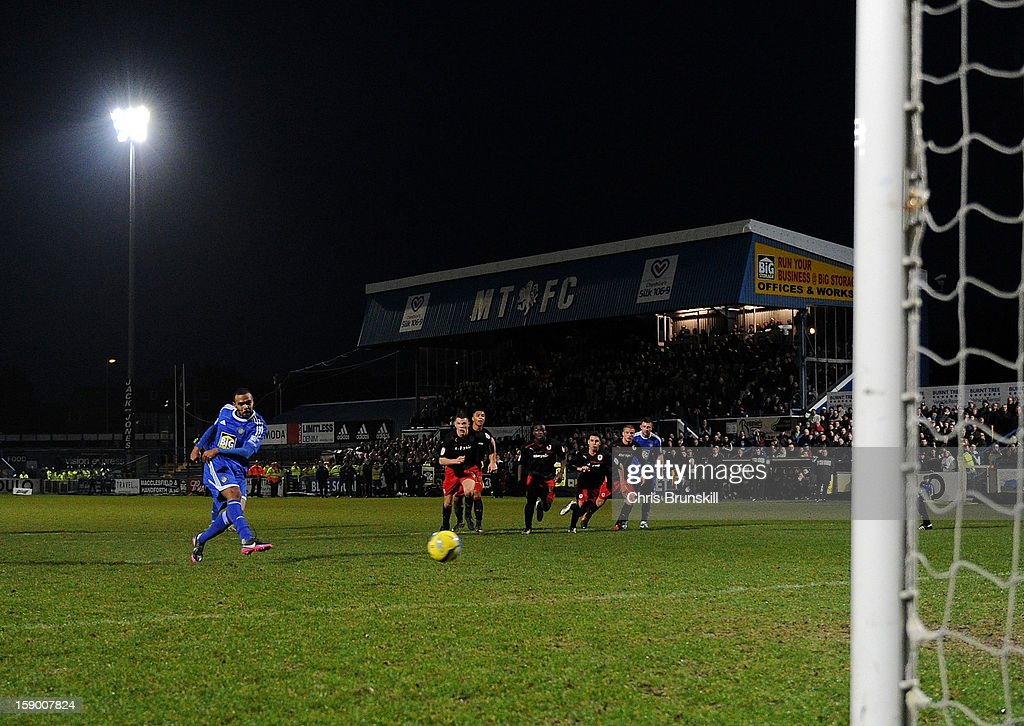 Matthew Barnes-Homer of Macclesfield Town scores the winning goal from the penalty spot during the FA Cup with Budweiser Third Round match between Macclesfield Town and Cardiff City at Moss Rose Ground on January 5, 2013 in Macclesfield, England.