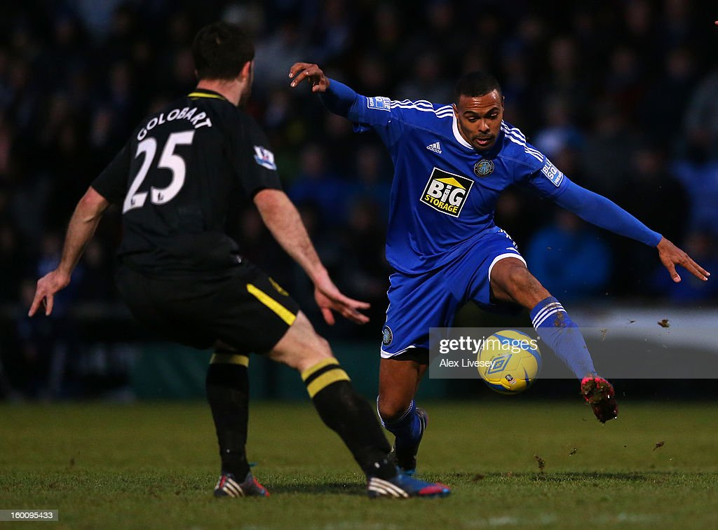 Matthew Barnes-Homer of Macclesfield Town tries to go past Roman Golobart of Wigan Athletic during the Budweiser FA Cup fourth round match between Macclesfield Town and Wigan Athletic at Moss Rose Ground on January 26, 2013 in Macclesfield, England.