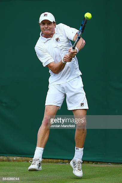 Matthew Barton of Australia plays a backhand during the Men's Singles second round match against John Isner of The United States on day five of the...