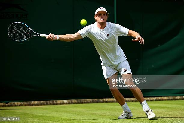 Matthew Barton of Australia plays a forehand during the Men's Singles second round match against John Isner of The United States on day five of the...