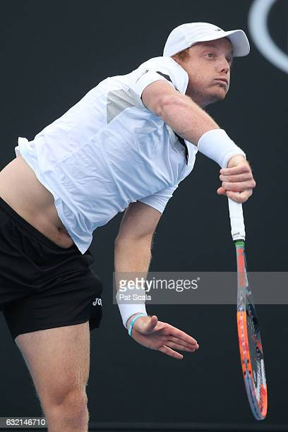 Matthew Barton of Australia plays a shot in his second round doubles match with Matthew Ebden of Australia against Pablo Carreno Busta and Guillermo...