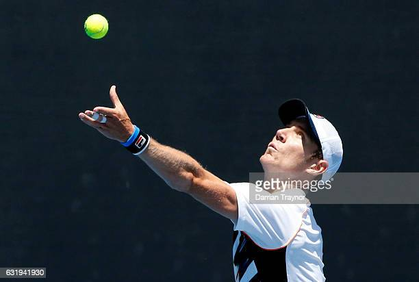 Matthew Barton of Australia serves during his first round doubles match against Vasek Pospisil of Canada and Radek Stepanek of the Czech Republic on...