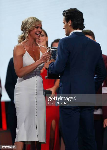 Matthew Barzal of the New York Islanders accepts the Calder Memorial Trophy from NHL Network presenter Kathryn Tappen during the 2018 NHL Awards...