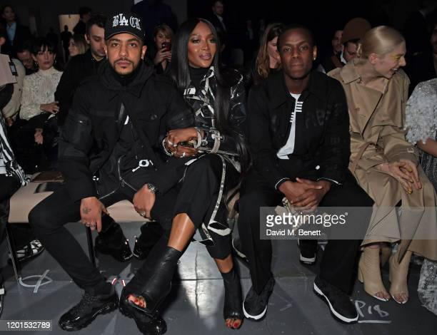 Matthew Baus Naomi Campbell and Micheal Ward attend the Burberry Autumn/Winter 2020 show during London Fashion Week at Kensington Olympia on February...
