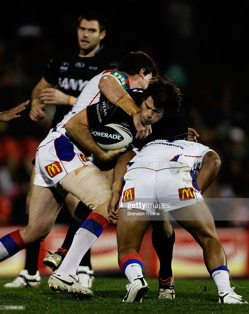 Matthew Bell of the Panthers is tackled by the Knights defence during the round 13 NRL match between the Penrith Panthers and the Newcastle Knights at CUA Stadium on June 5, 2010 in Sydney, Australia.