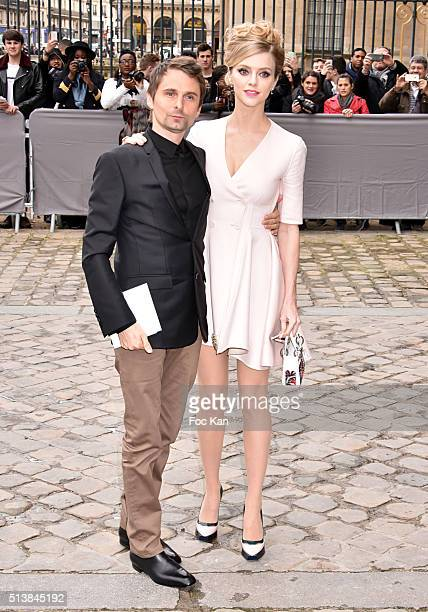 Matthew Bellamy and Elle Evans attend the Christian Dior show as part of the Paris Fashion Week Womenswear Fall/Winter 2016/2017 on March 4 2016 in...