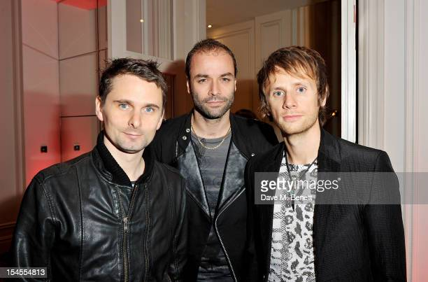 Matthew Bellamy Chris Wolstenholme and Dominic Howard of Muse arrive at The Q Awards 2012 at the Grosvenor House Hotel on October 22 2012 in London...