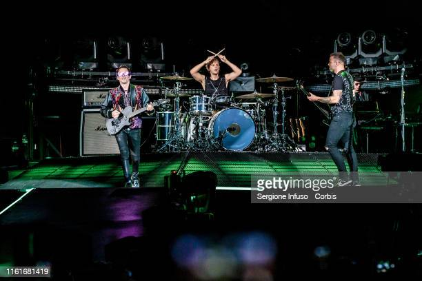 Matthew Bellamy, Dominic Howard and Chris Wolstenholme of Muse perform at the San Siro Stadium on July 12, 2019 in Milan, Italy.