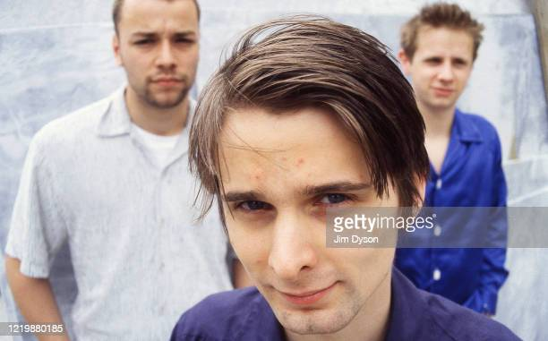 Matthew Bellamy, Dominic Howard and Christopher Wolstenholme of British rock group Muse pose, circa June 1999 as they promote their debut album...