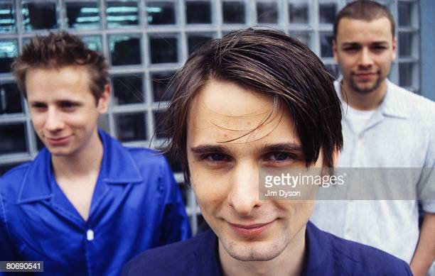 Matthew Bellamy Dominic Howard and Christopher Wolstenholme of British rock group Muse pose circa June 1999 as they promote their debut album...