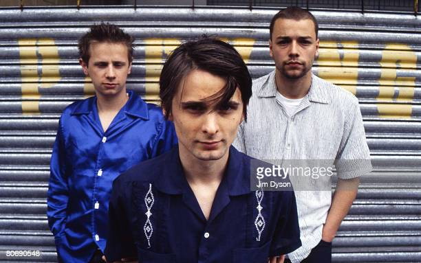 Matthew Bellamy , Dominic Howard and Christopher Wolstenholme of British rock group Muse pose, circa June 1999 as they promote their debut album...