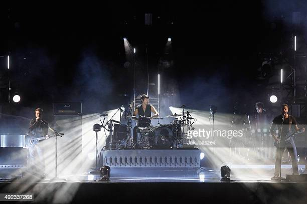 Matthew Bellamy Dominic Howard and Christopher Wolstenholme of the band Muse perform during the second day of the Lollapalooza Berlin music festival...