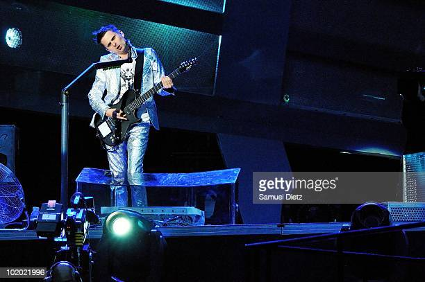 Matthew Bellamy of Muse perform live at Stade de France on June 11, 2010 in Paris, France.