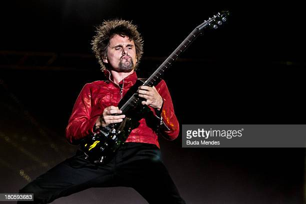 Matthew Bellamy of MUSE performs on stage during a concert in the Rock in Rio Festival on September 14, 2013 in Rio de Janeiro, Brazil.