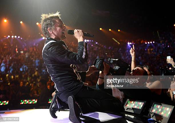 Matthew Bellamy of Muse performs onstage during the iHeartRadio Music Festival at the MGM Grand Garden Arena on September 20, 2013 in Las Vegas,...