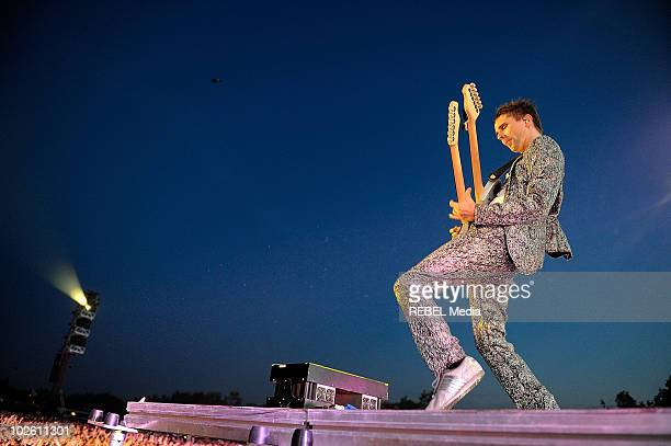 """Matthew Bellamy of the british rock band """"Muse"""" performs on stage on day 3 at the Roskilde Festival on July 3, 2010 in Roskilde, Denmark."""