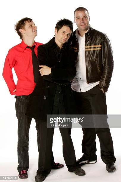 Matthew Bellamy poses with his band Muse for a studio portrait during the MTV Europe Music Awards 2004 at Tor di Valle November 18, 2004 in Rome,...