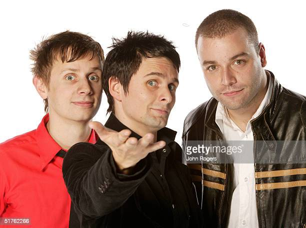 Matthew Bellamy poses with his band Muse for a studio portrait during the MTV Europe Music Awards 2004 at Tor di Valle November 18 2004 in Rome Italy