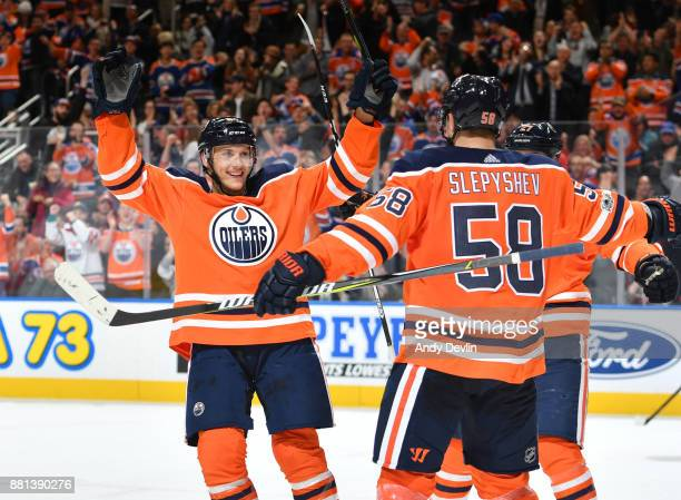 Matthew Benning and Anton Slepyshev of the Edmonton Oilers celebrate after a goal during the game against the Arizona Coyotes on November 28 2017 at...