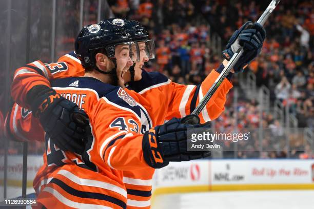 Matthew Benning and Josh Currie of the Edmonton Oilers celebrate after a goal during the game against the Anaheim Ducks on February 23 2019 at Rogers...