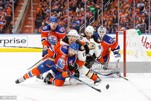 Matthew Benning and Kris Russell of the Edmonton Oilers battle against Corey Perry and Antoine Vermette of the Anaheim Ducks in Game Six of the...