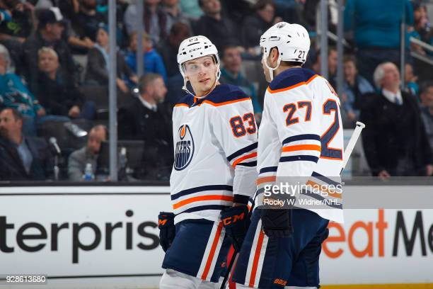 Matthew Benning and Milan Lucic of the Edmonton Oilers talk during the game against the San Jose Sharks at SAP Center on February 27 2018 in San Jose...