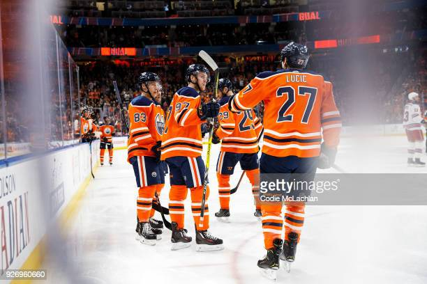 Matthew Benning Connor McDavid Leon Draisaitl and Milan Lucic of the Edmonton Oilers celebrate a goal against the New York Rangers at Rogers Place on...