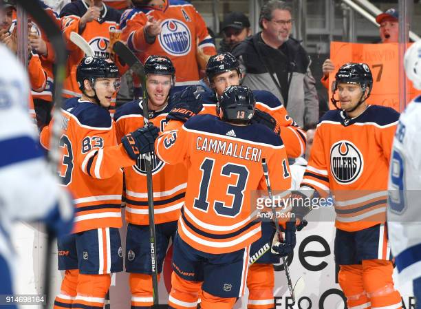 Matthew Benning Connor McDavid Leon Draisaitl Andrej Sekera and Michael Cammalleri of the Edmonton Oilers celebrate after a goal during the game...