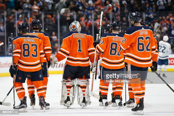 Matthew Benning goaltender Laurent Brossoit Yohann Auvitu and Eric Gryba of the Edmonton Oilers skate off after losing to the Toronto Maple Leafs at...