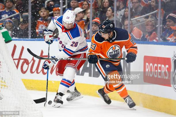 Matthew Benning of the Edmonton Oilers battles against Chris Kreider of the New York Rangers at Rogers Place on March 3 2018 in Edmonton Canada