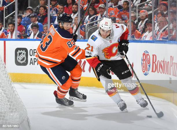 Matthew Benning of the Edmonton Oilers battles for the puck against Lee Stempniak the Calgary Flames on October 4 2017 at Rogers Place in Edmonton...