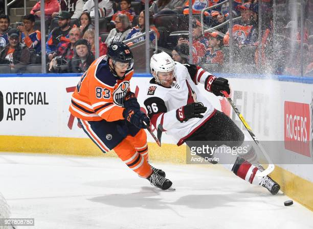 Matthew Benning of the Edmonton Oilers battles for the puck against Christian Fischer of the Arizona Coyotes on March 5 2018 at Rogers Place in...