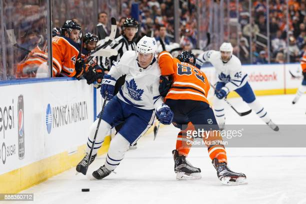 Matthew Benning of the Edmonton Oilers defends against Patrick Marleau of the Toronto Maple Leafs at Rogers Place on November 30 2017 in Edmonton...