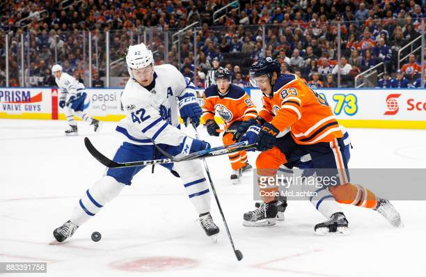 Matthew Benning of the Edmonton Oilers defends against Tyler Bozak of the Toronto Maple Leafs at Rogers Place on November 30 2017 in Edmonton Canada