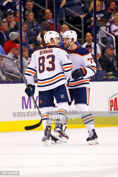 Matthew Benning of the Edmonton Oilers is congratulated by Oscar Klefbom of the Edmonton Oilers after scoring a goal during the second period on...