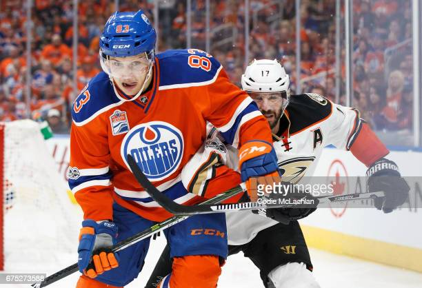 Matthew Benning of the Edmonton Oilers is pursued by Ryan Kesler of the Anaheim Ducks in Game Three of the Western Conference Second Round during the...
