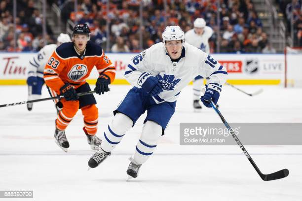 Matthew Benning of the Edmonton Oilers pursues Mitch Marner of the Toronto Maple Leafs at Rogers Place on November 30 2017 in Edmonton Canada