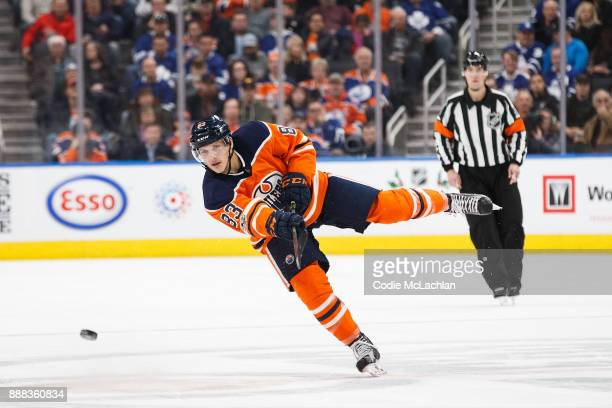 Matthew Benning of the Edmonton Oilers shoots the puck against the Toronto Maple Leafs at Rogers Place on November 30 2017 in Edmonton Canada