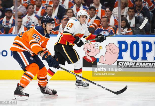 Matthew Benning of the Edmonton Oilers skates against Johnny Gaudreau of the Calgary Flames at Rogers Place on October 4 2017 in Edmonton Canada