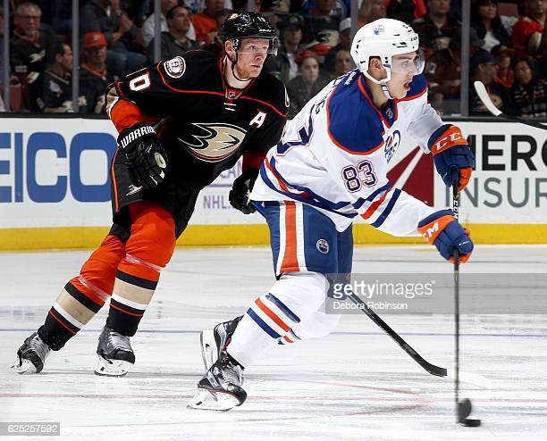 Matthew Benning of the Edmonton Oilers skates with the puck against Corey Perry of the Anaheim Ducks on November 15 2016 at Honda Center in Anaheim...