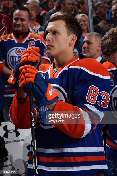 Matthew Benning of the Edmonton Oilers stands for the singing of the national anthem prior to the game against the Arizona Coytoes on January 16 2017...