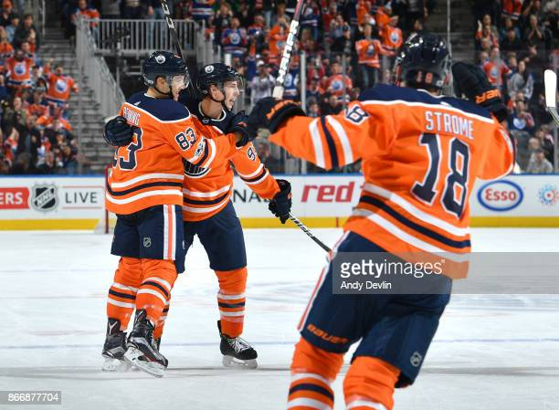 Matthew Benning Ryan NugentHopkins and Ryan Strome of the Edmonton Oilers celebrate after a goal during the game against the Dallas Stars on October...