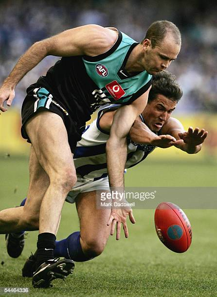 Matthew Bishop for the Power leads Nathan Thompson for the Kangaroos during the AFL Second Elimination Final between the Kangaroos and the Port...