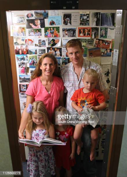 Matthew Blair wife Heidrun Blair and their three kids Rebecca Amy and James pose for photos on Logos Hope the ship which carries the world's largest...